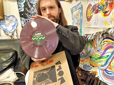 Thomas Nöla holds a vinyl record of one his own albums released on his record label Disques de Lapin.