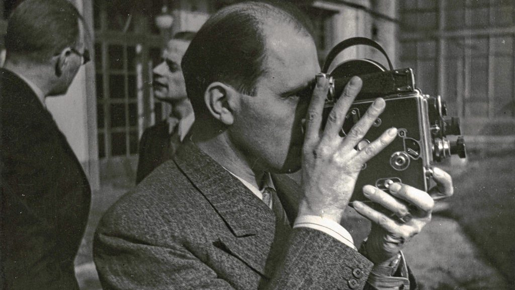 Bolex inventor Jacques Bolsey holds his invention.