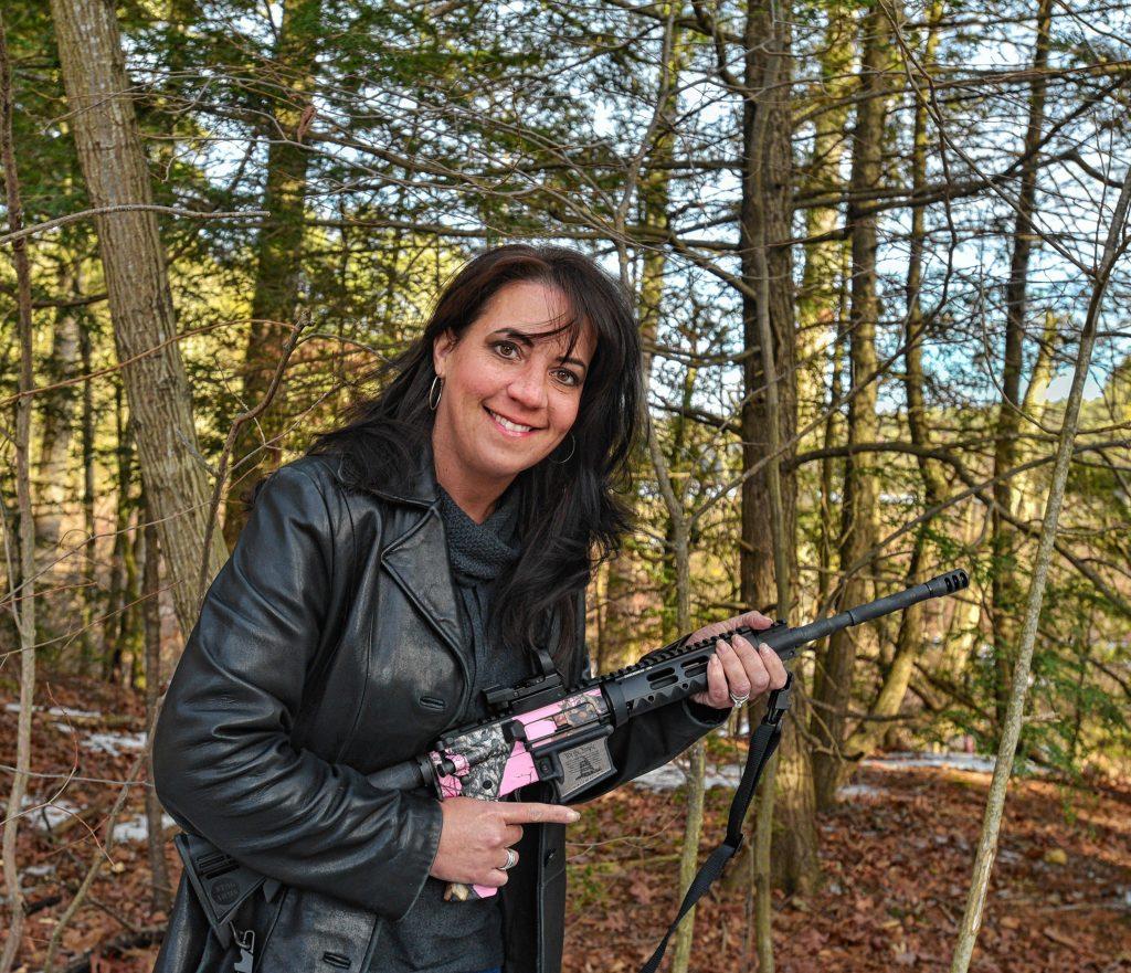 Joelene Guzzo, of Wilbraham, holds her AR-15 rifle, Thursday, Jan. 9, 2020 in Florence.