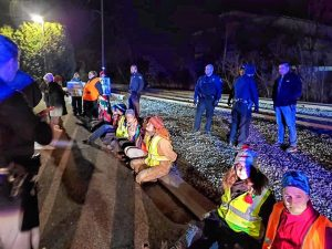 On Saturday, December 28, climate activists blocked a train in Worcester heading to the Merrimack Generating Station in Bow, New Hampshire. Ten activists out of nearly two dozen were arrested that night.