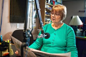 Volunteer Jeanne DelMonte reads from the Springfield Republican in Valley Eye Radio's Springfield studios Friday afternoon.