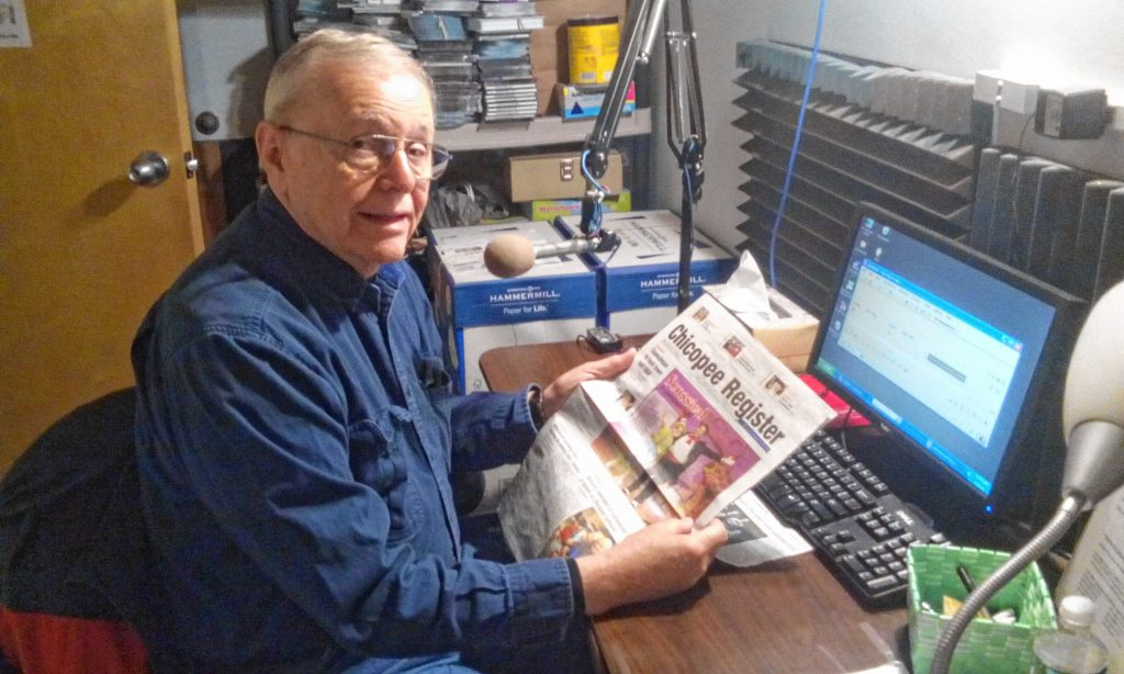 "David Manning reads from the ""Chicopee Register"" at Valley Eye Radio's Springfield studios."