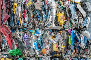 Bales of rigid plastics stacked at the Springfield Materials Recycling Facility on Tuesday, Feb. 4, 2020.