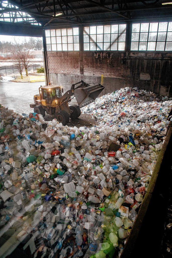A frontloader consolidates a mound of plastic at the Springfield Materials Recycling Facility on Tuesday, Feb. 4, 2020.