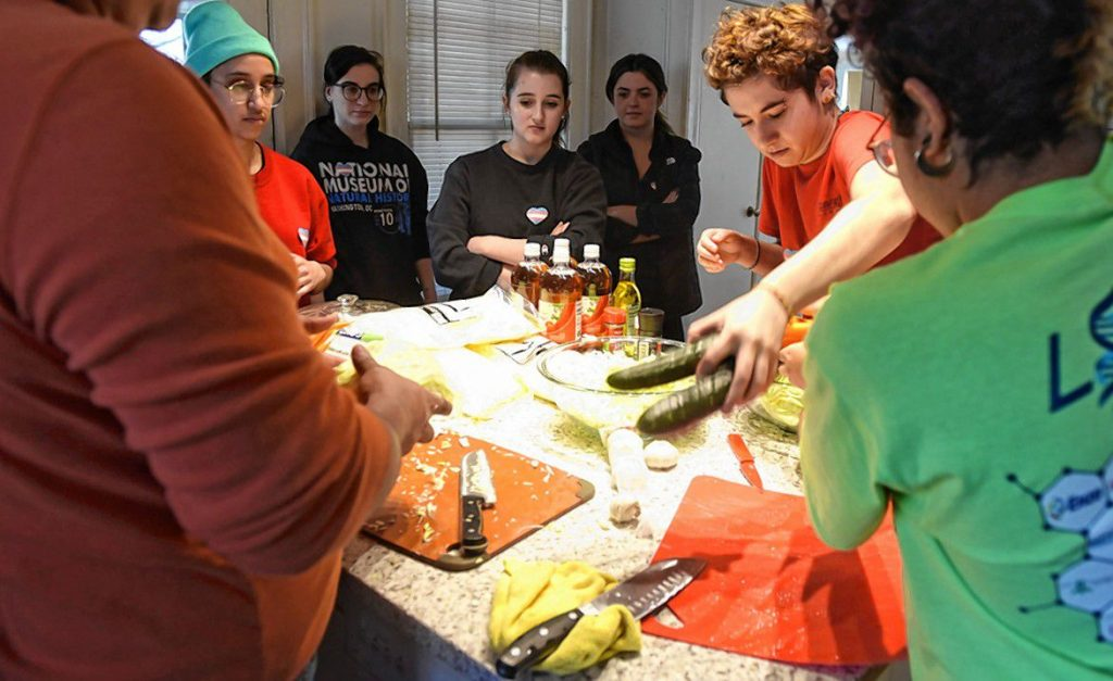 Jax Padilla, Rafaella Fabrizi, Joelle Bueno, and Zulay Holland watch along with others in a pupusa-making event, a collaboration between the Trans Asylum Seeker Support Network and a UMass Amherst anthropology class taught by Meredith Degyansky and Boone Shear. Natty demonstrates how to make pupusas.