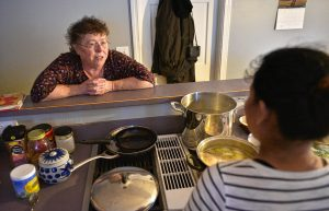 Lynne, left, talks with a woman she has given asylum to as she makes dinner in her kitchen, Thursday, Jan. 30.