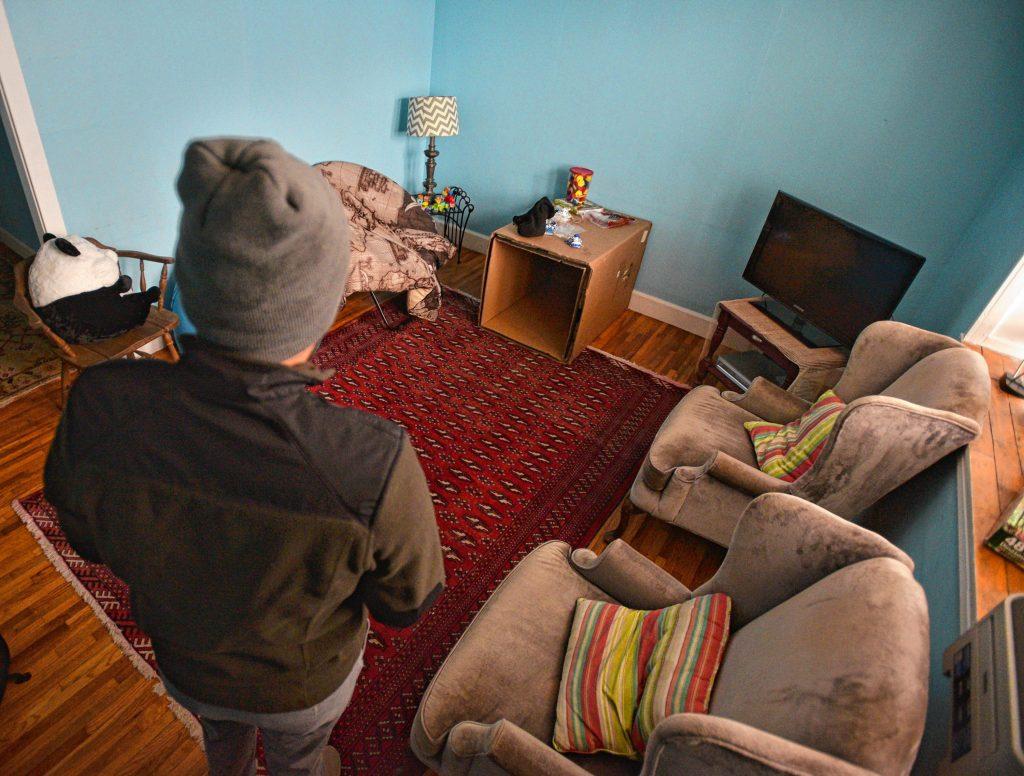 A man seeking asylum in the living room of his apartment, Tuesday, Feb. 11, 2020.