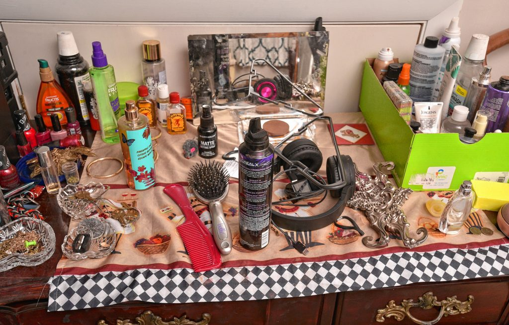 Personal care products and other items rest on a chest in Natty's room, Friday, Mar. 6, 2020 at the home of her sponsor.