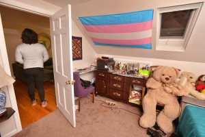 Natty stands at the door to her room at the home of her sponsor, Friday, Mar. 6, 2020.