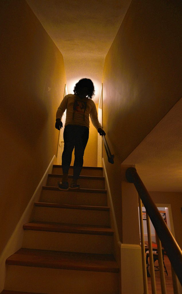 Natty walks down stairs from her room at the home of her sponsor, Friday, Mar. 6, 2020.