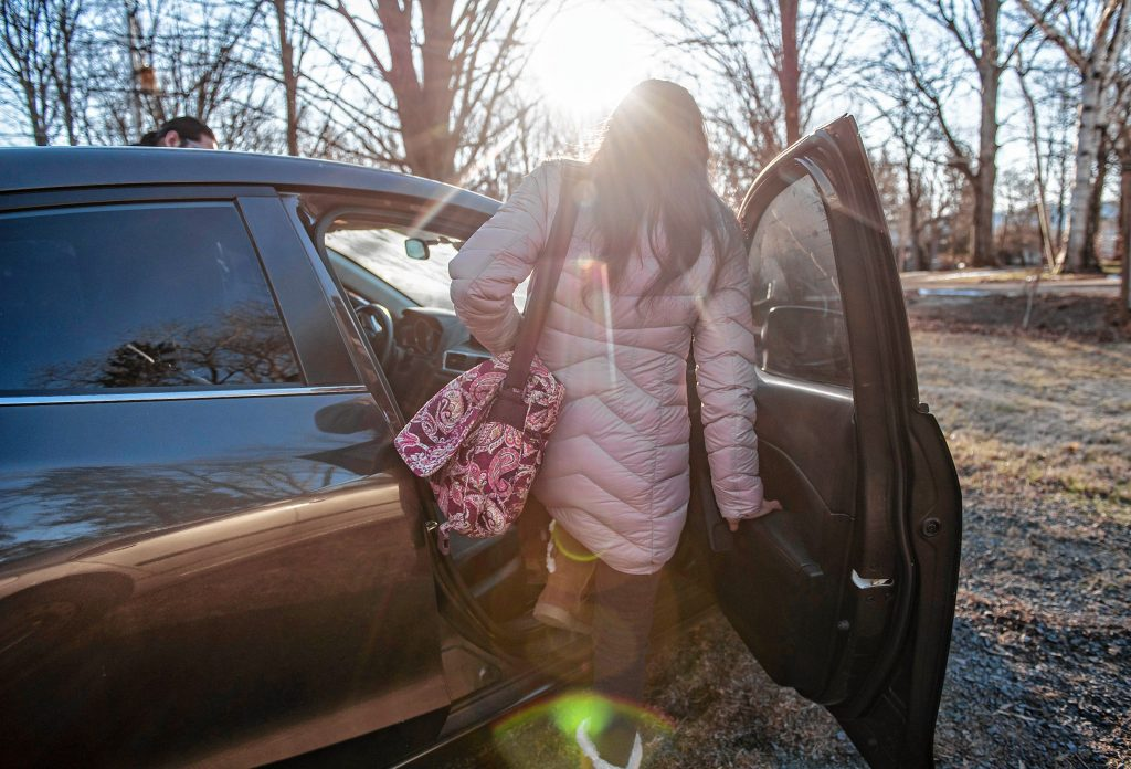 A woman in the process of seeking asylum gets a ride with a Western Massachusetts Asylum Support Network volunteer to take her to the Immigration and Customs Enforcement office in Hartford from Hadley on Wednesday morning, Jan. 29, 2020.