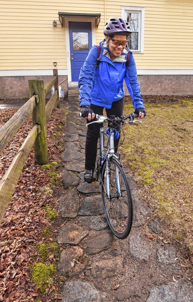 Andrea Hairston heads out for a ride from her home in Florence in mid March. She uses a bike for virtually all her transportation.