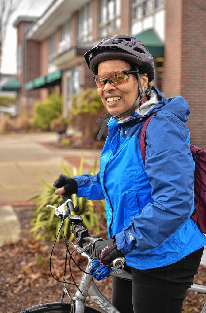 "Andrea Hairston, who teaches writing at Smith College, near Chestnut Street in Florence. She uses a bicycle year-round for transportation. ""I love the independence of getting around on a bike,"" she says."