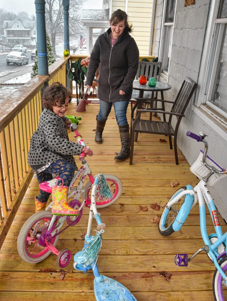 Sadie Cora, who is a third grade teacher in Northampton, with her daughter, Alice, 5, at their home in Holyoke, Monday, Mar. 23, 2020.