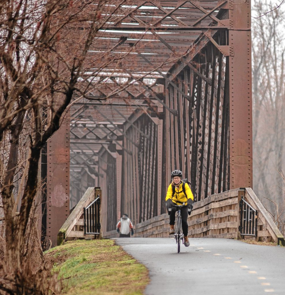 Physical therapist Jess Goldberg of Florence has regularly commuted by bicycle to her job in Hadley. Here she's seen on the Norwottuck Rail Trail on her way to Tran's World Food Market in Hadley.