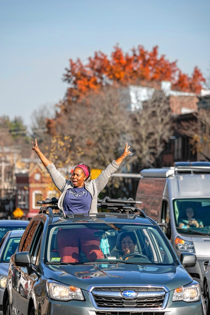 Cars paraded along Main Street Saturday in Downtown Northampton, honking horns and cheering along with the raucous crowd celebrating former Vice President Joe Biden's election victory.