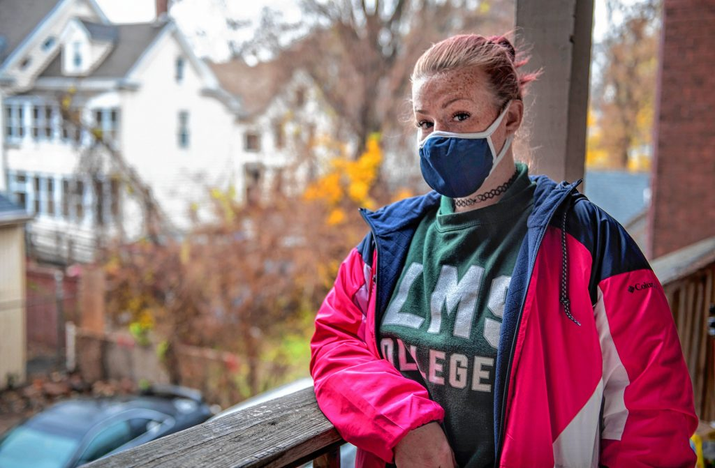 Paige Spaulding stands outside of her apartment in Chicopee on Friday, Nov. 13, 2020.