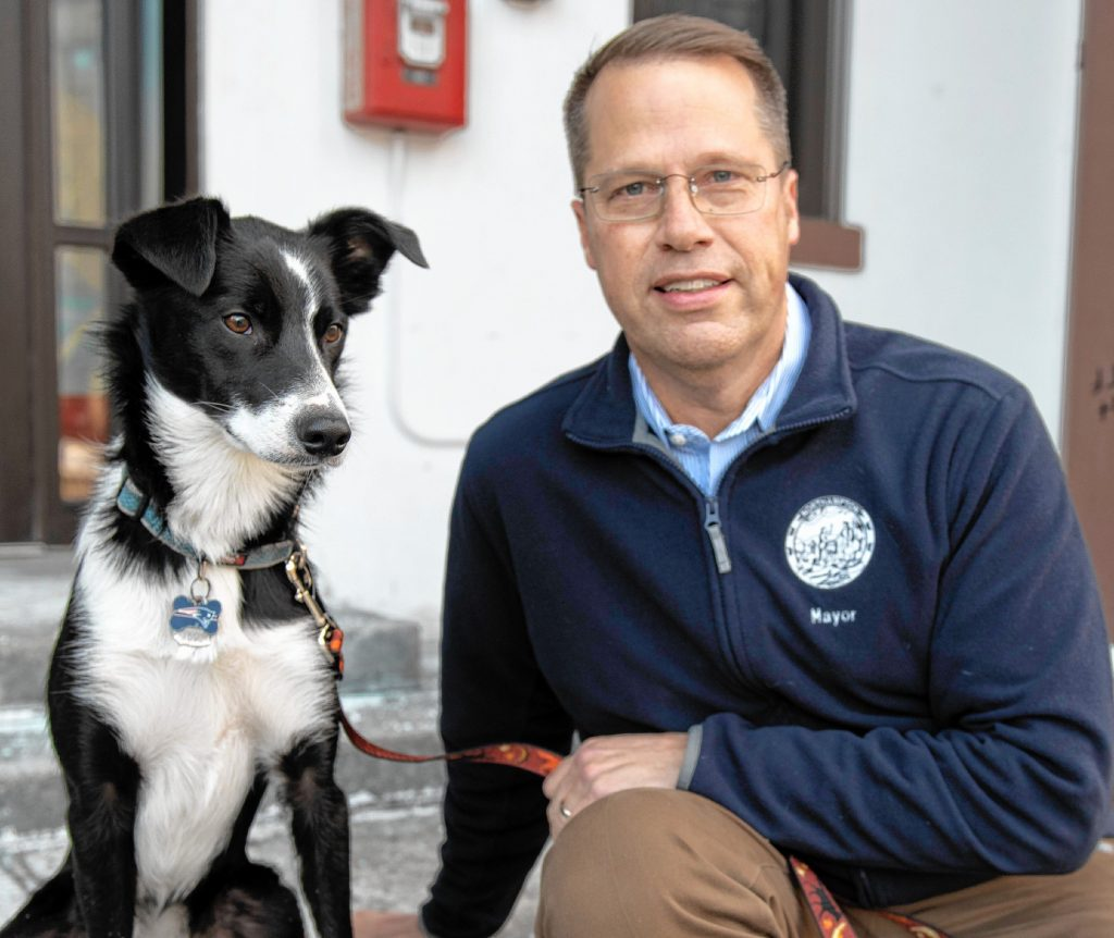 Northampton Mayor David Narkewicz, and his dog Scout, in front of the Northampton City Hall on Feb. 11.