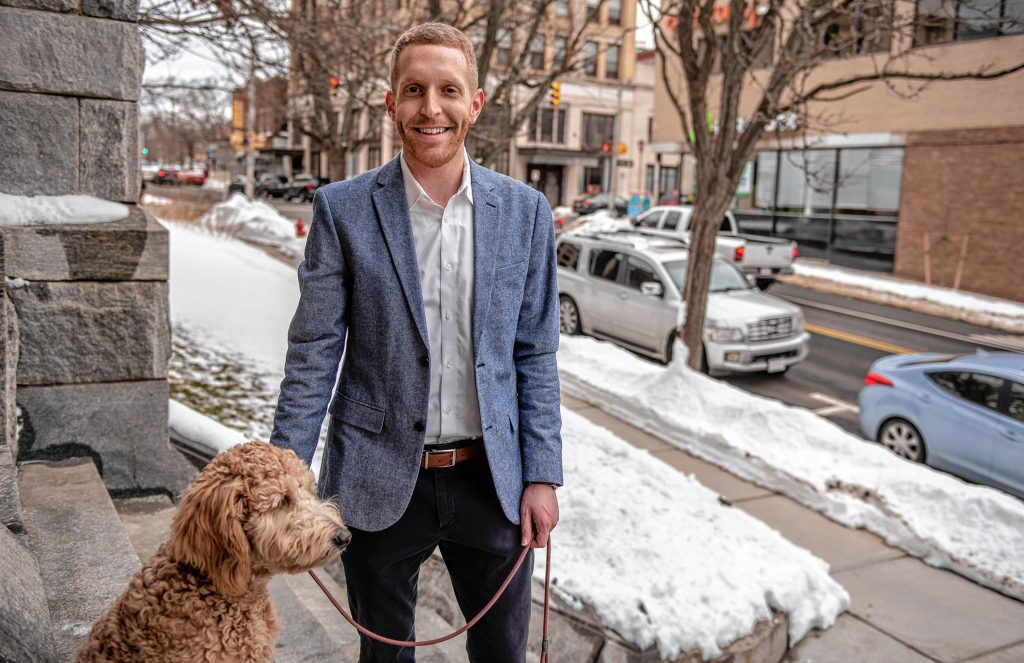 Holyoke Mayor Alex Morse takes his dog, Oliver, a six-month-old labradoodle, for a walk outside City Hall on Thursday, Feb. 4, 2021.