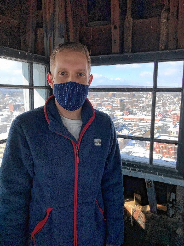 Holyoke Mayor Alex Morse in the  bell tower on top of Holyoke's centuries-old City Hall, which offers a  view of the entire city.