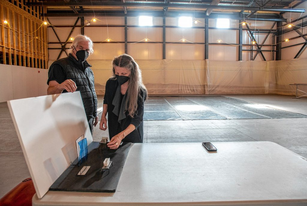 Serious Play Theatre Managing Director Robin Doty, left, and Artistic Director Sheryl Stoodley work with a mock up of the troupe's current production in the Workroom space at the Northampton Community Arts Trust building on Tuesday, April 13, 2021.