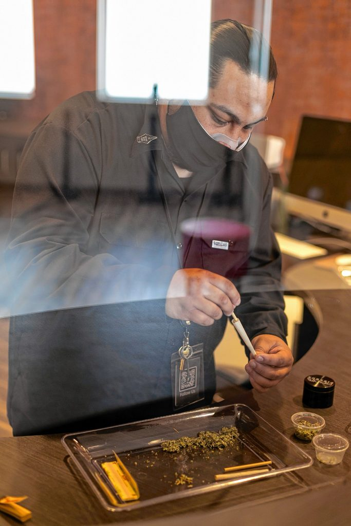 Steven Robles, of Northampton, packs a prerolled cone during a joint-rolling demonstration April 18  at Turning Leaf Centers dispensary in Northampton.