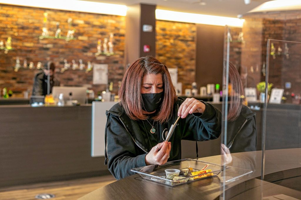Turning Leaf Centers Marketing and Outreach Coordinator Nicole Desjardins, of Easthampton, packs a prerolled cone during a joint-rolling demonstration April 18 at the dispensary  in Northampton.