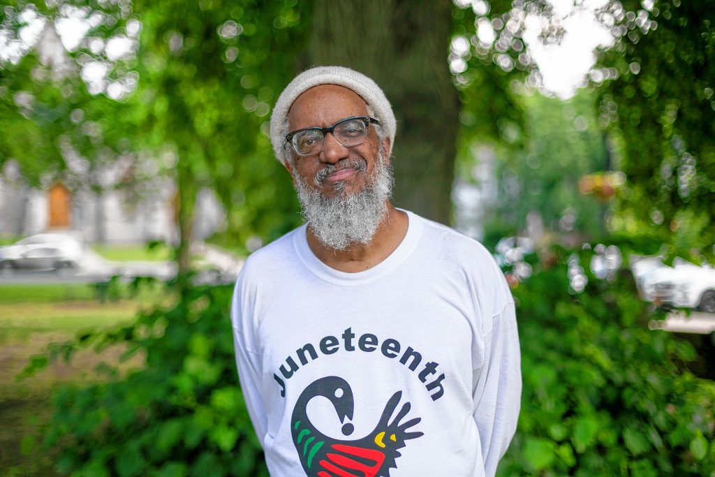 Dr. Amilcar Shabazz, Professor at the W.E.B. DuBois Department of African American Studies at UMASS Amherst, stands outside a Juneteenth Community Jubilee Celebration in the town common, Saturday in Amherst, MA.