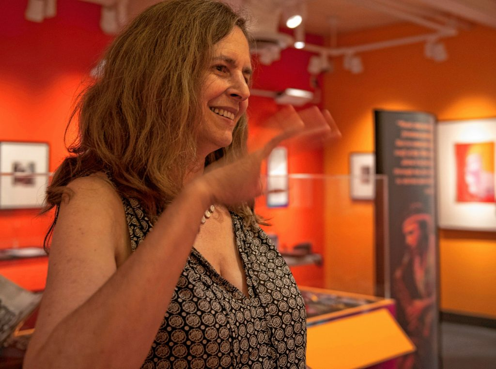 """Kristin Neville says her late husband saw music as a key means of bringing people together and bridging divides. """"Music was his passion,"""" she says."""