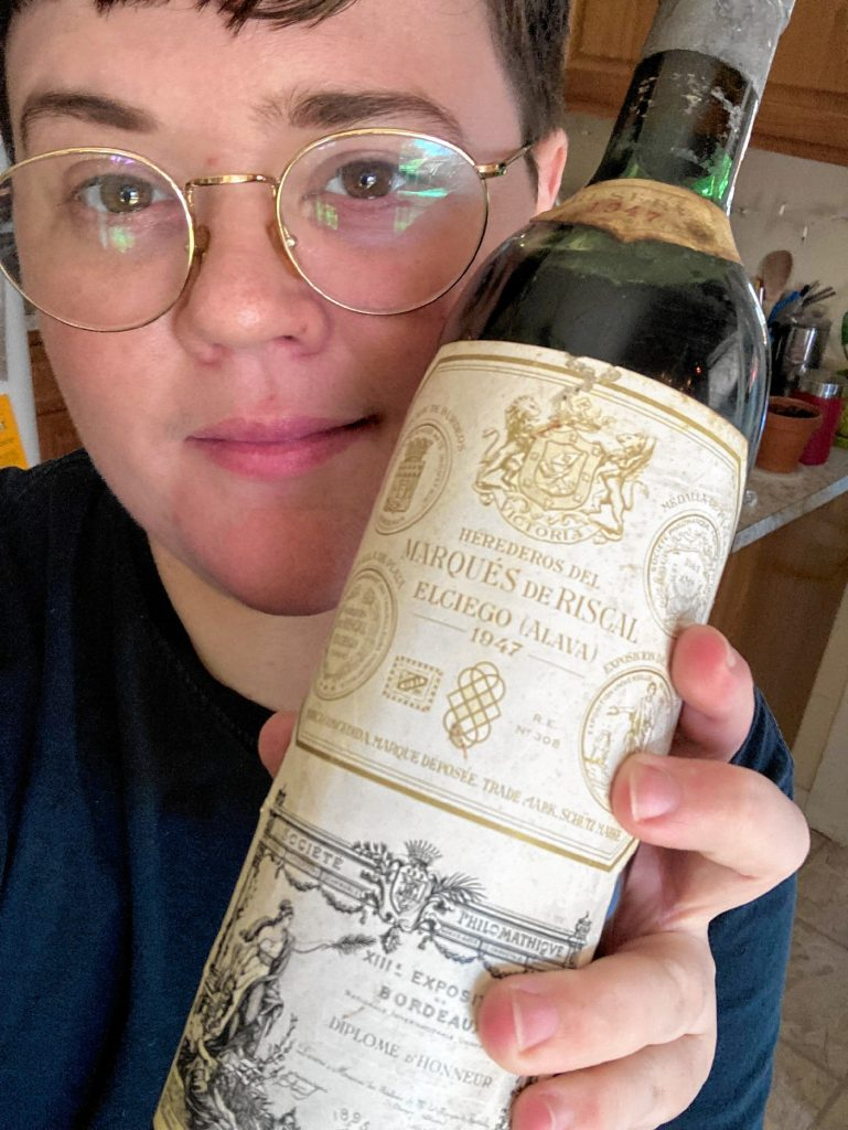 Ken Washburn, 31, discovered wine in their early 20s, spent some time perfecting their skills in Dallas, which is also where they came out as trans. They now live in Turners Falls and are ready to dole out wine advice, even if drinking it gives them a headache.