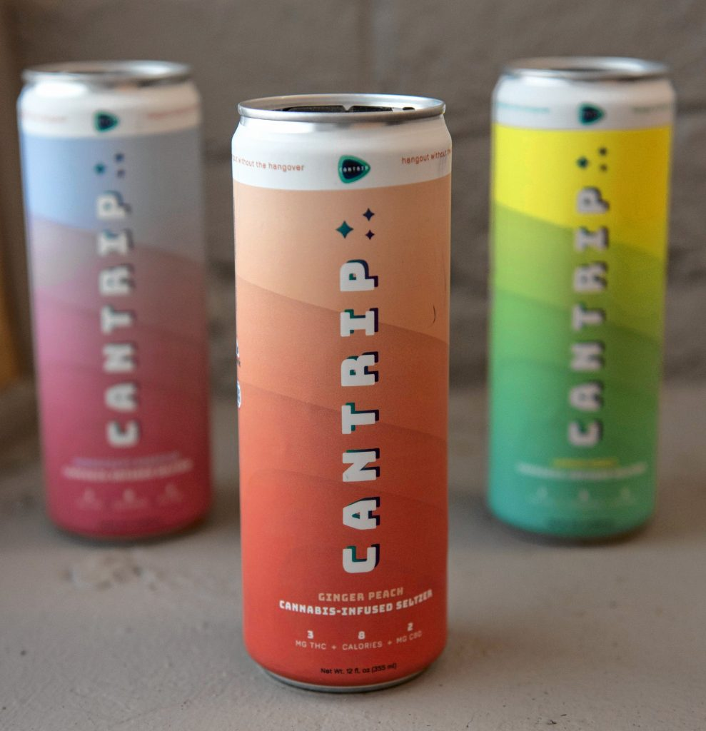 Jacob Black, the marketing an purchasing manager at Holyoke Cannabis, holds Cantrip, a seltzer infused with cannabis.