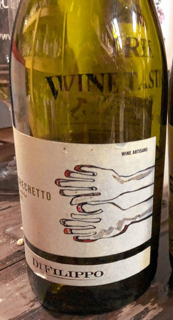 Grechetto Bianco del'Umbria IGT from the maker DiFillipo.  This wine has  a beautiful minerality, notes of peach and stone fruit, with a golden straw color. It's dry and rustic, with a good balance of acid, fruit and sweetness.  State Street had it on sale for less than $15.