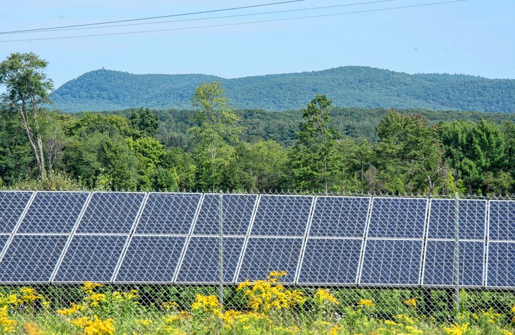A view looking north, toward Mount Toby, over an approximately 30-acre solar farm north of Pulpit Hill Road in Amherst on Monday, Aug. 16, 2021.
