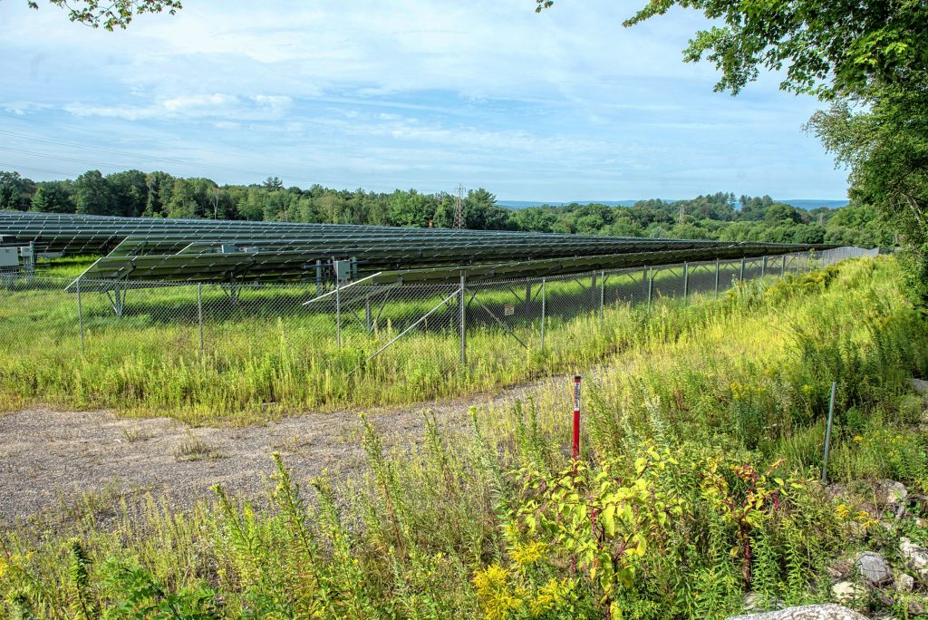 A view looking southwest over an approximately 30-acre solar farm north of Pulpit Hill Road in Amherst on Monday, Aug. 16, 2021.